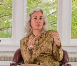FAQs-Teresa-in-chair-Living-Intuitive-counseling-Birth-Intuitive